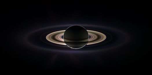 The rings of Saturn arranged in a fractal structure, as seen by the Cassini spacecraft. (Earth is the small dot at the upper-left of the rings)(Wikimedia Commons)